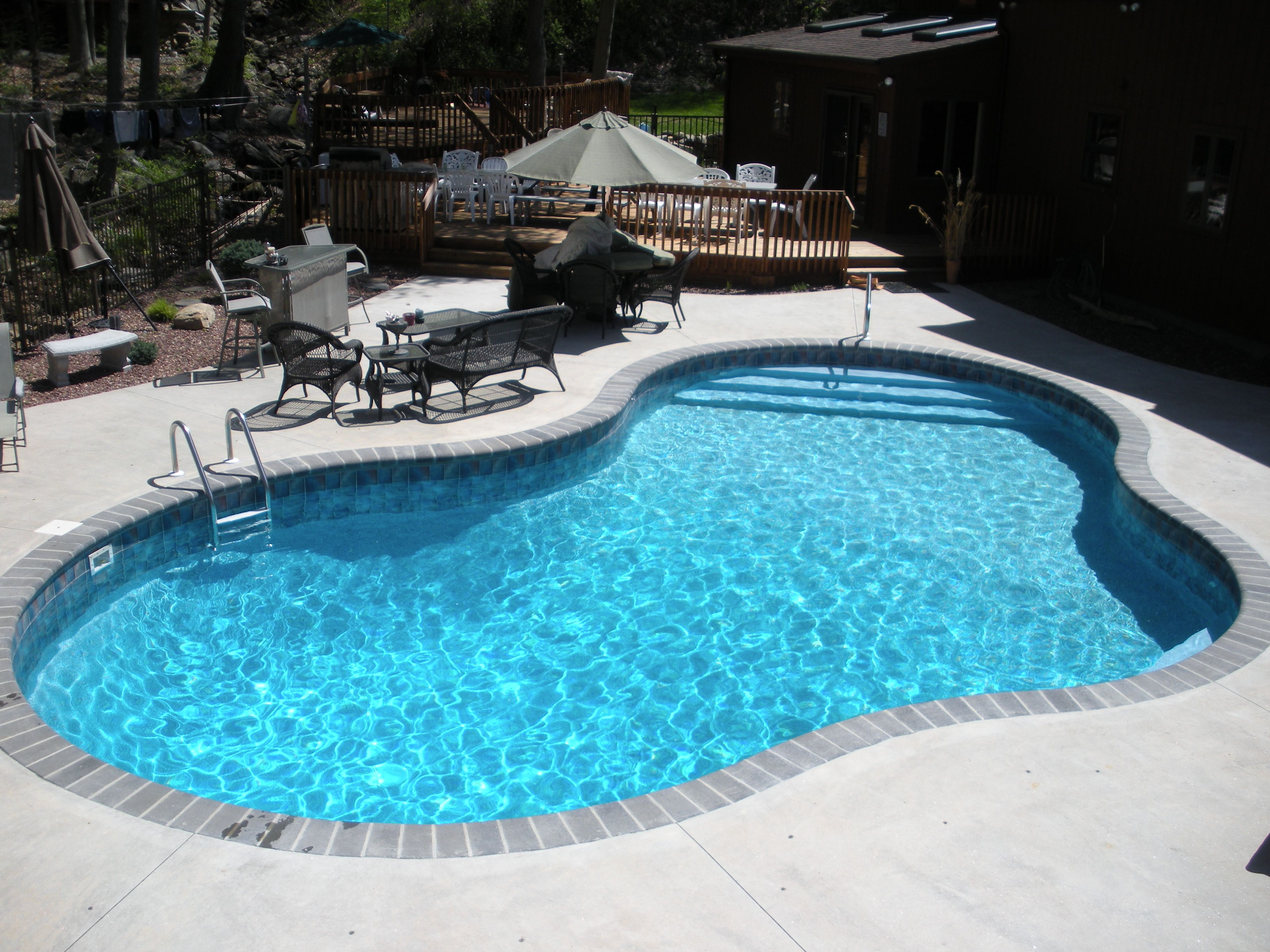 Vinyl Lined in-ground pool, w/custom steel stairs and bench - Mountain