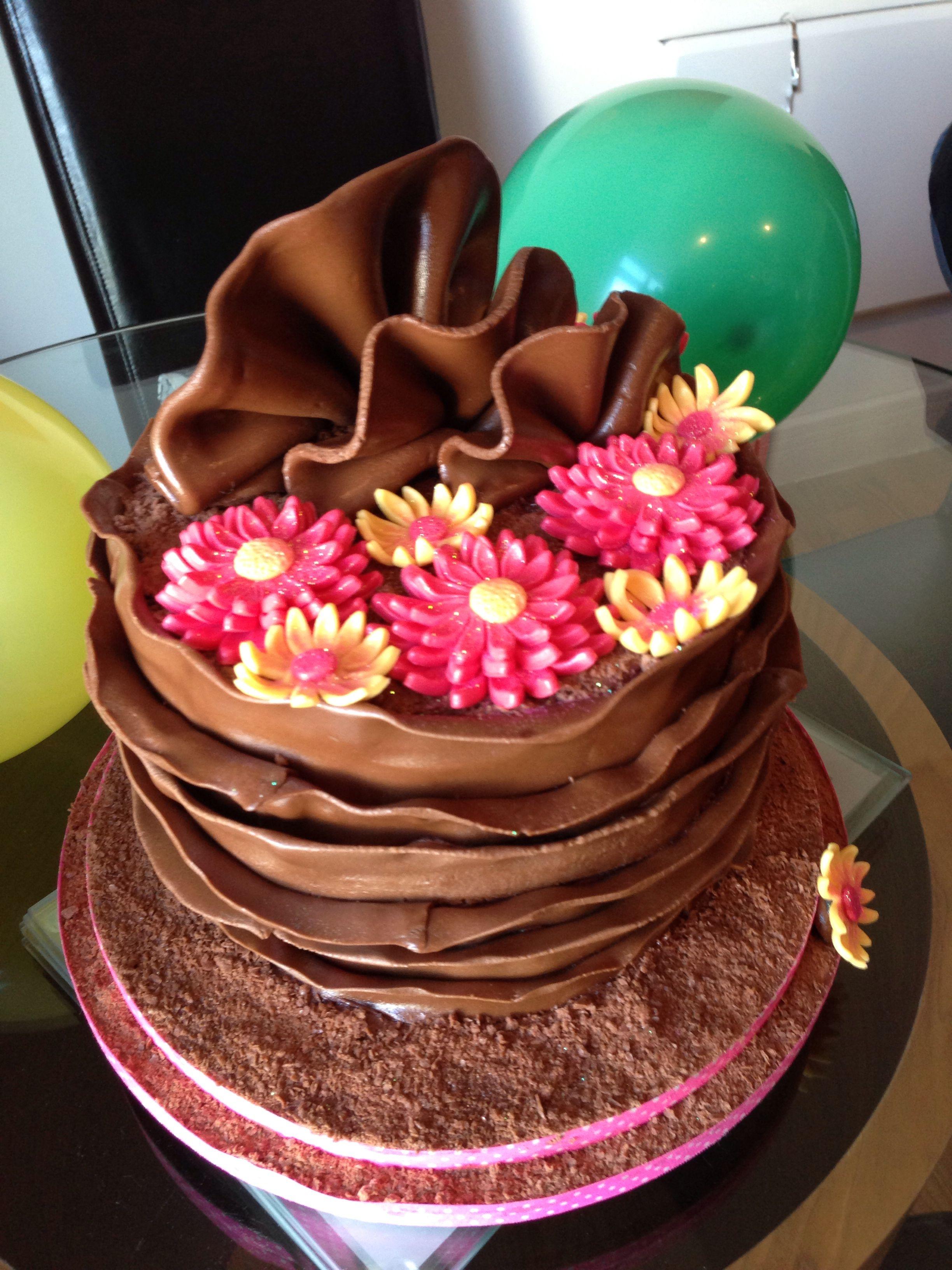Chocolate mud cake with fondant flowers