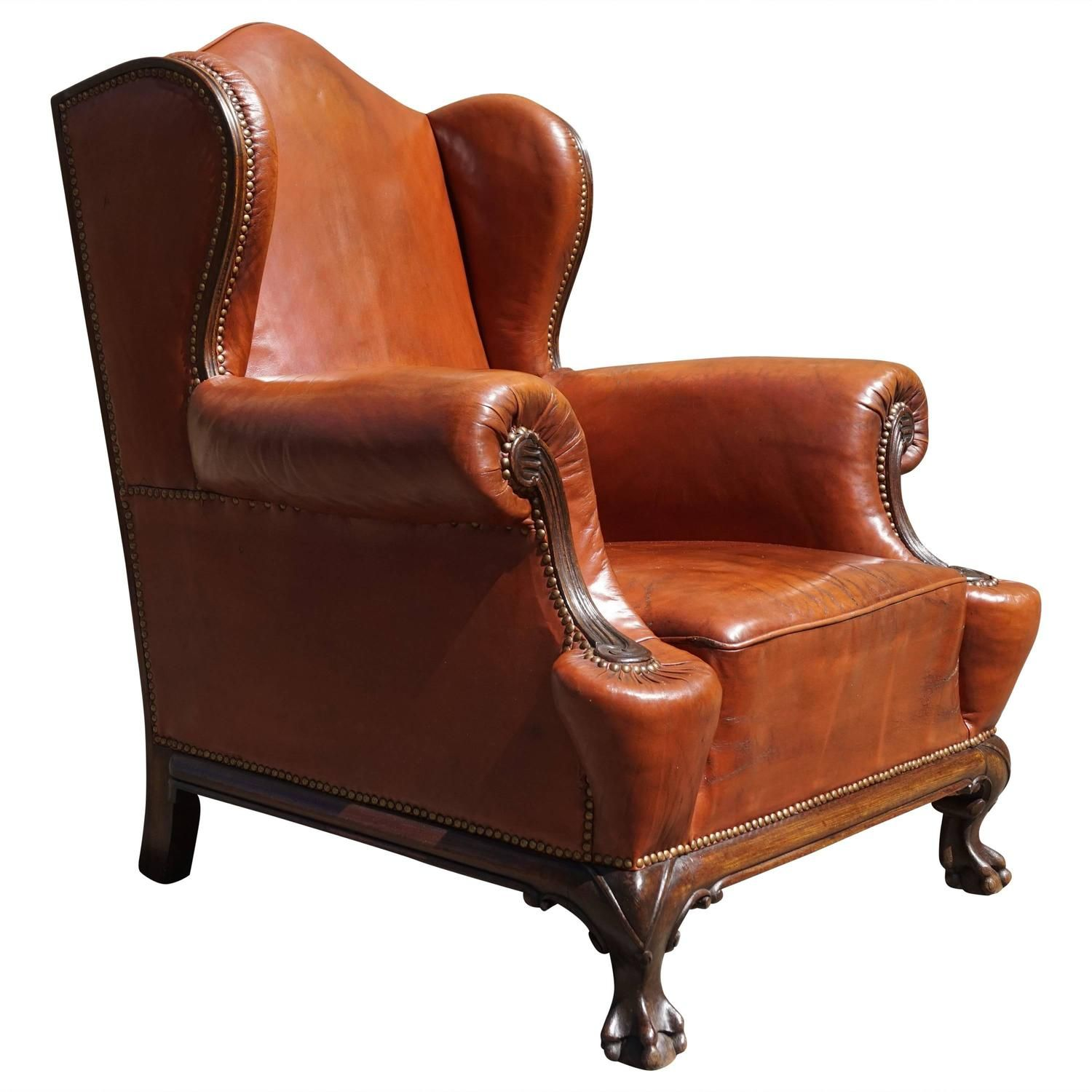 antique leather chippendale style wingback chair with hand carved