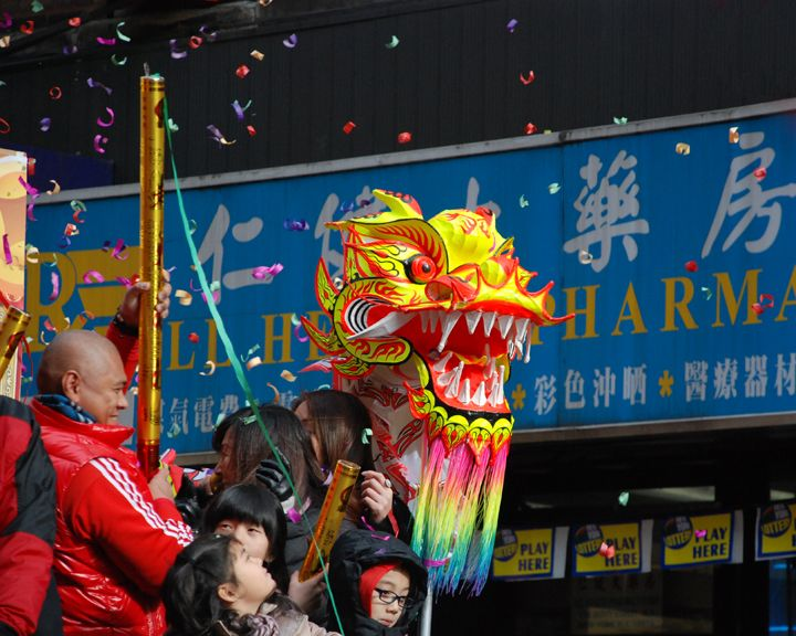 Holy Cow! There's Confetti Too? http://thecaffeinateddaytripper.com/2013/12/13/how-you-too-can-accidentally-celebrate-at-the-chinese-lunar-new-year-parade-in-nyc/