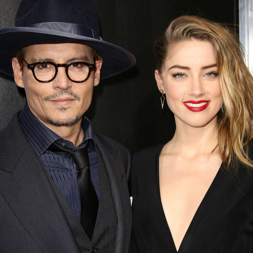 Amber Heard Flashes Engagement Ring While Snuggling Up To Johnny Depp