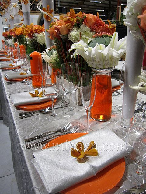 Orange And Silver Wedding Table Orchids Lilies Weddings