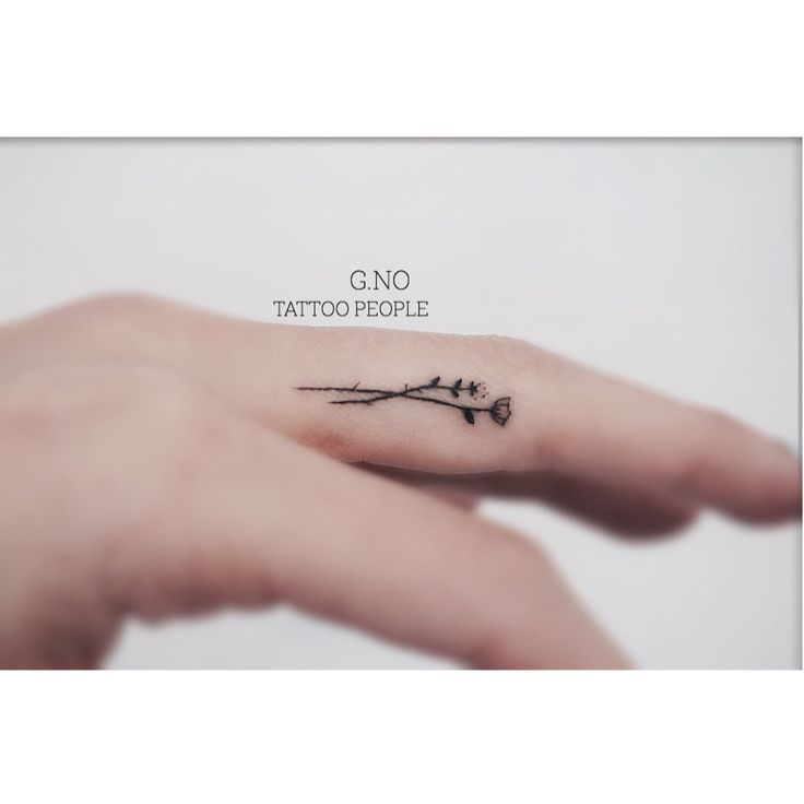 Simple, tiny flower finger tattoo