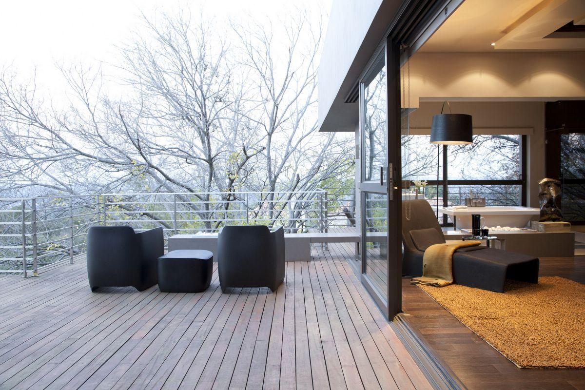 Modern minimalist terrace design surrounding trees porch for Terrace trees
