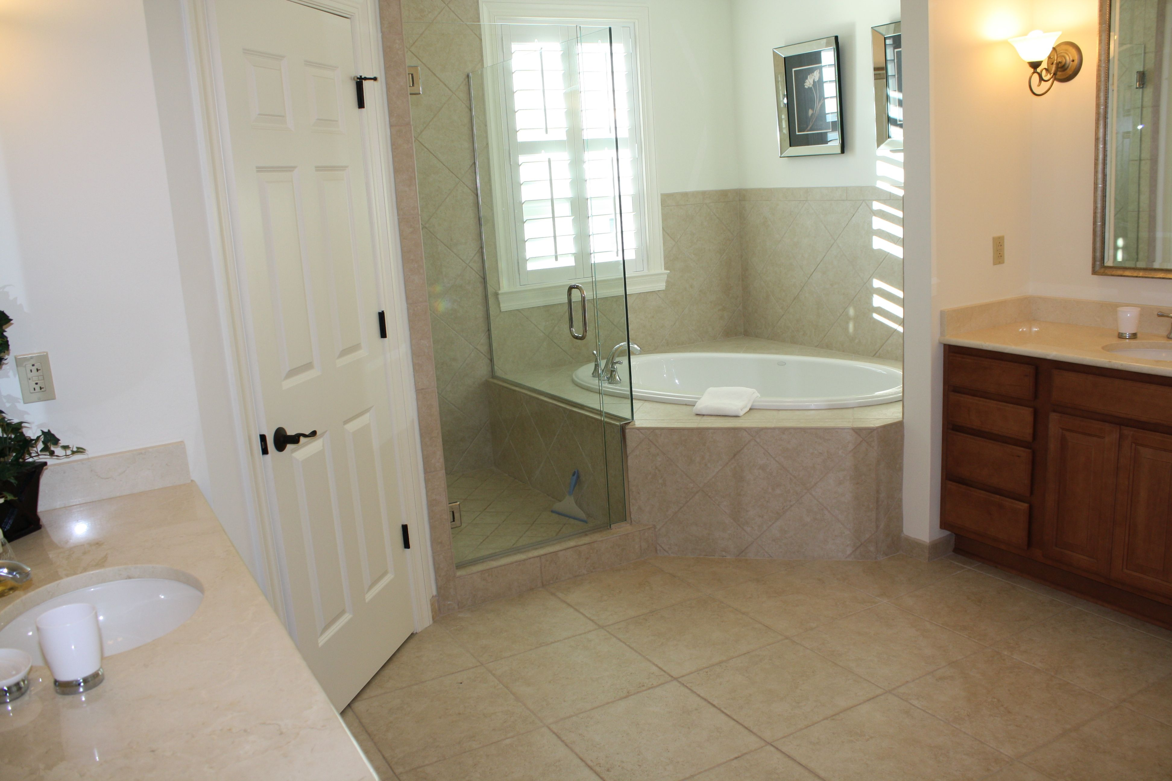 Where glass is wall with built in shelves for towels shallow so as ...