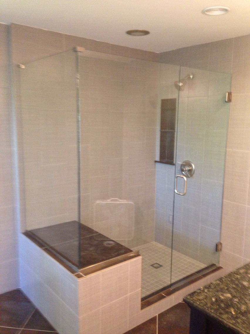 Frameless door, notched panel with a return panel. Clear glass ...