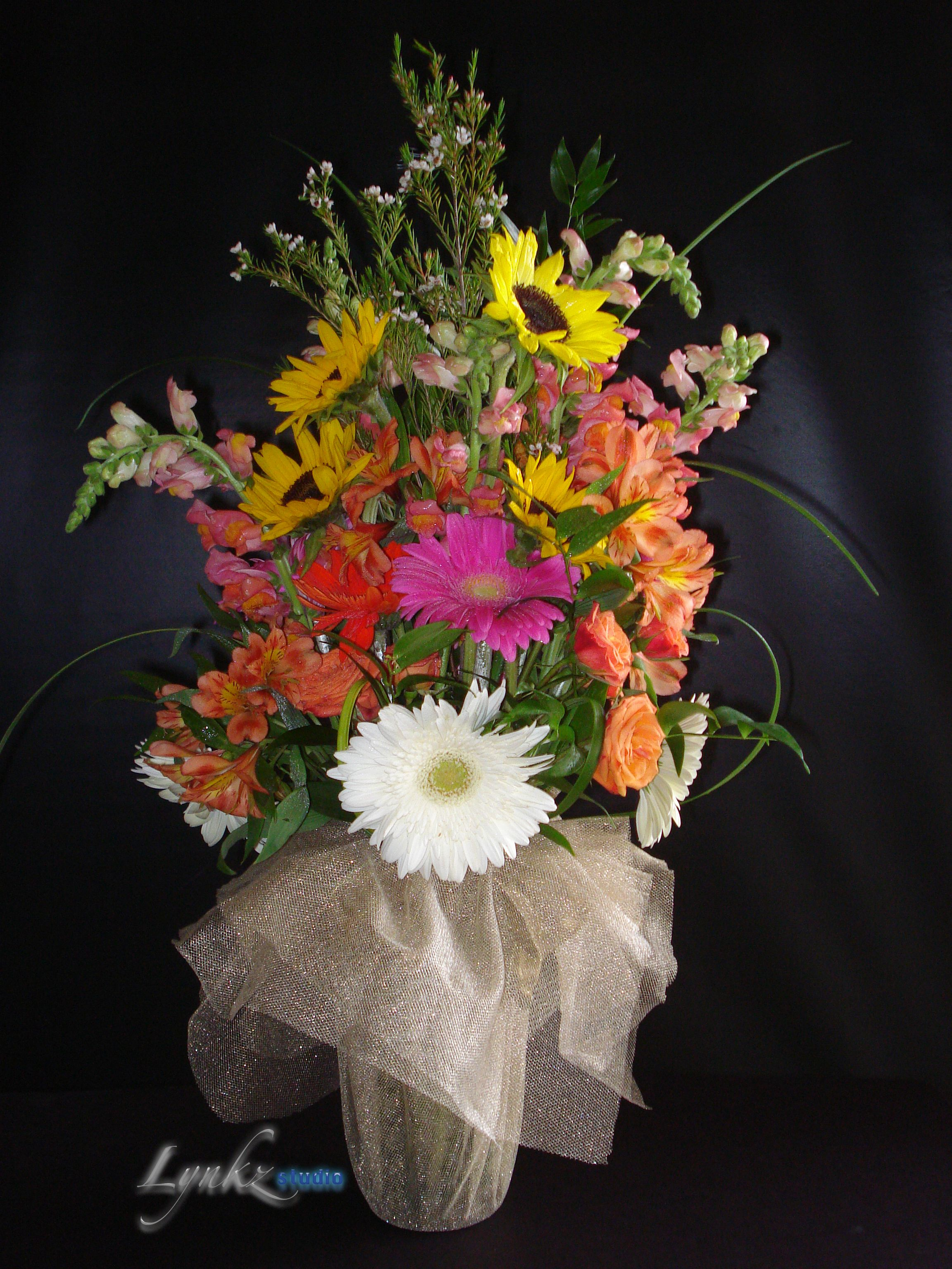 ceremony arrangement as a bouquet from sunflowers, gerbera daisy and ...