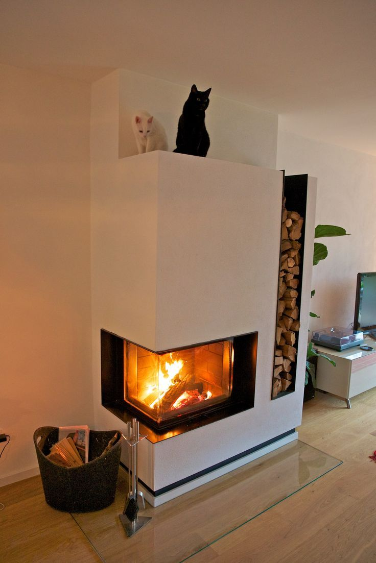 modern corner wood burning fireplace with firewood storage on the, Wohnzimmer dekoo