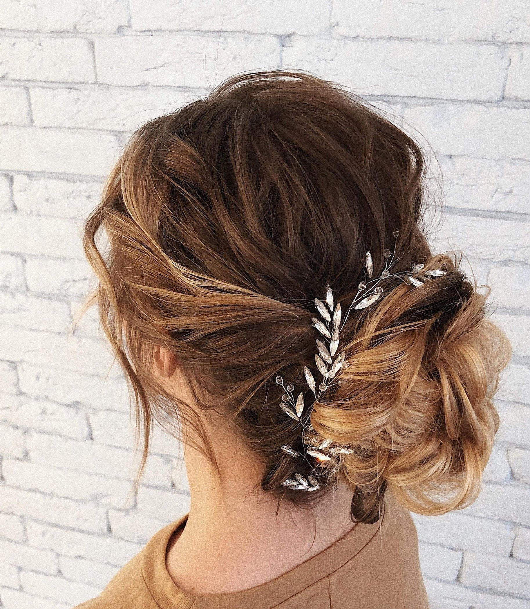 formal prom hairstyles vine accessory piece simple leaves minimal crystal pieces