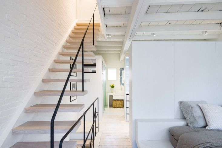 Matiz Architecture and Design, New York Apartment, Architect Is In   Remodelista cantilevered treads and custom made metal banisters.