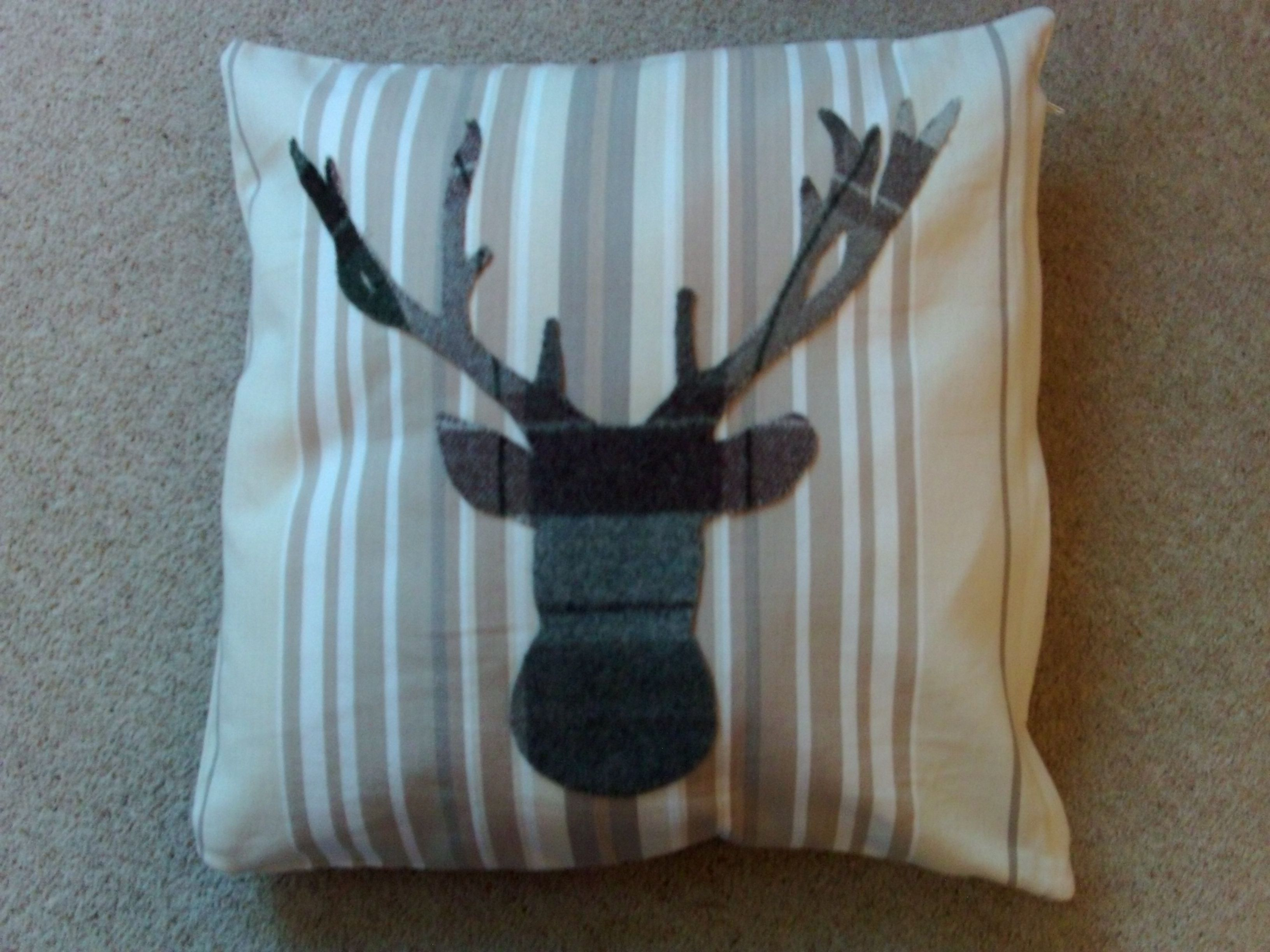 My homemade cushion cover and hand stitched applique stag
