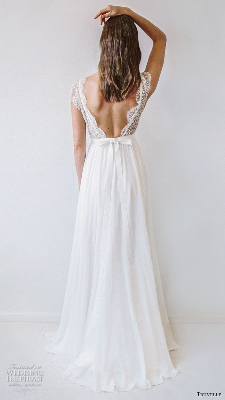 Truvelle bridal cap sleeves deep plunging v neckline heavily