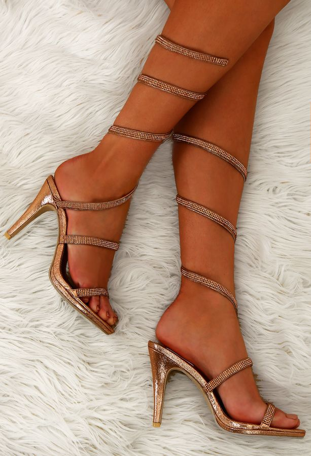 These rose gold sandals feature a stiletto heel and diamante detail on the  straps. These strappy rose gold heels wrap all the way up the calf in a  spiral ...