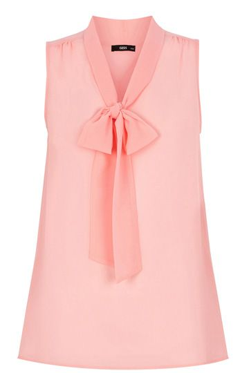 We absolutely love this adorable blouse. The cute pussy bow detail round the neck, and the floaty material with a pleated back means that it looks perfect both tucked in, or worn loose.