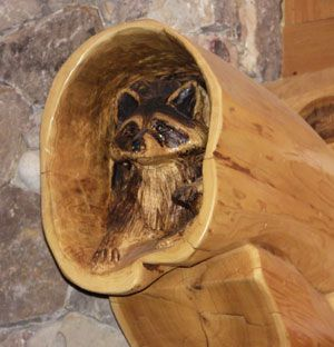 Animal Wood Log Carvings | Carved support is added as home is built.