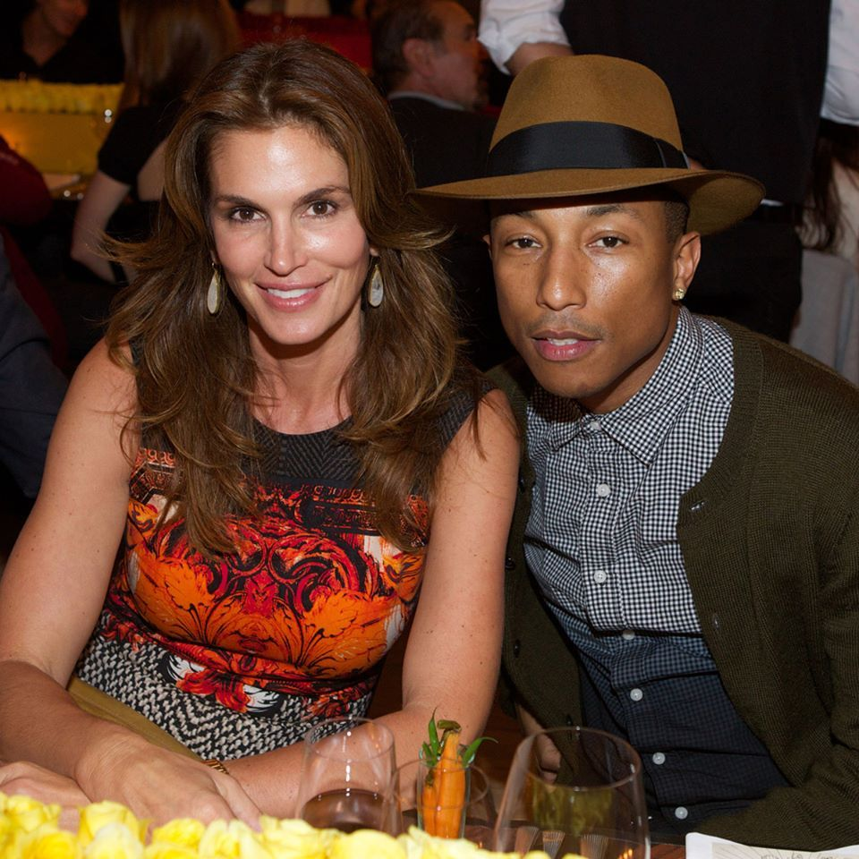 Cindy Crawford and Pharell Williams at the Louis Vuitton dinner celebrating the realization of La Maison au Bord de l'Eau for Design Miami 2013.