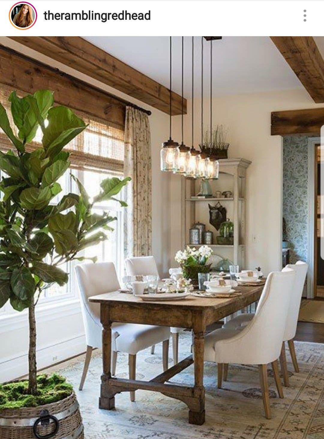 Gorgeous farmhouse dining room. Life the big farmhouse beams