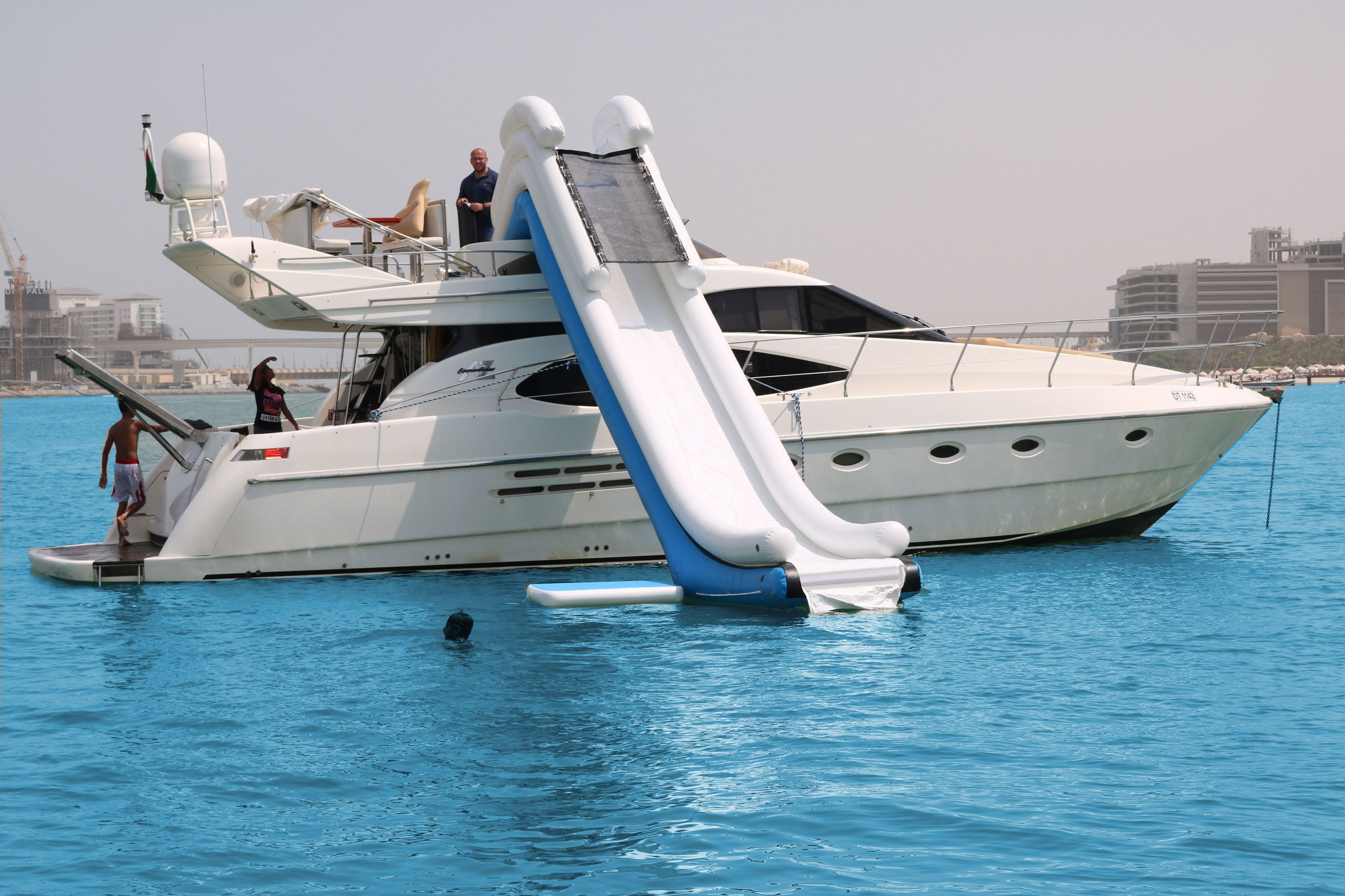 Rent a private yacht charter with a water slide in Dubai! Charter this yacht  and cruise along Dubai's coastline. To book, click … | Boat rental, Boat,  Private yacht