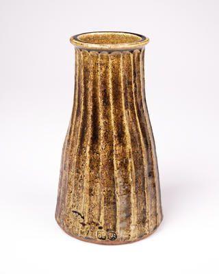 Bernard Leach, Cutsided vase with everted rim. stoneware, raw ash glaze...