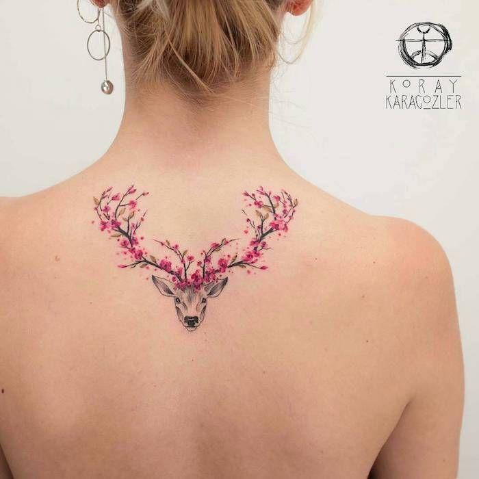 Tattoo bedeutung frau mit tattoo am r cken hirsch mit for Minimalist bedeutung