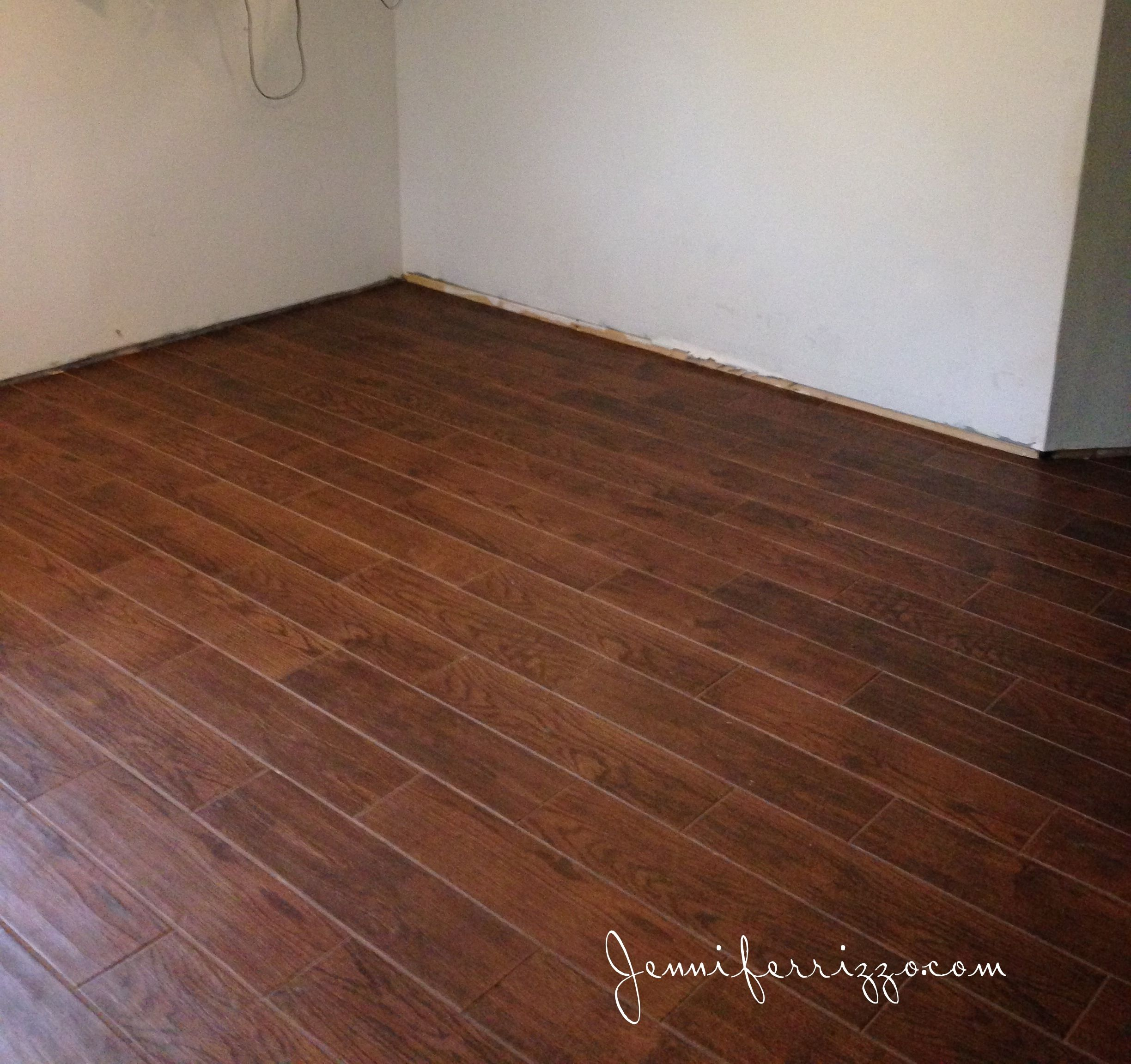 Installation of our wood look ceramic tile from Home Depot in our ...