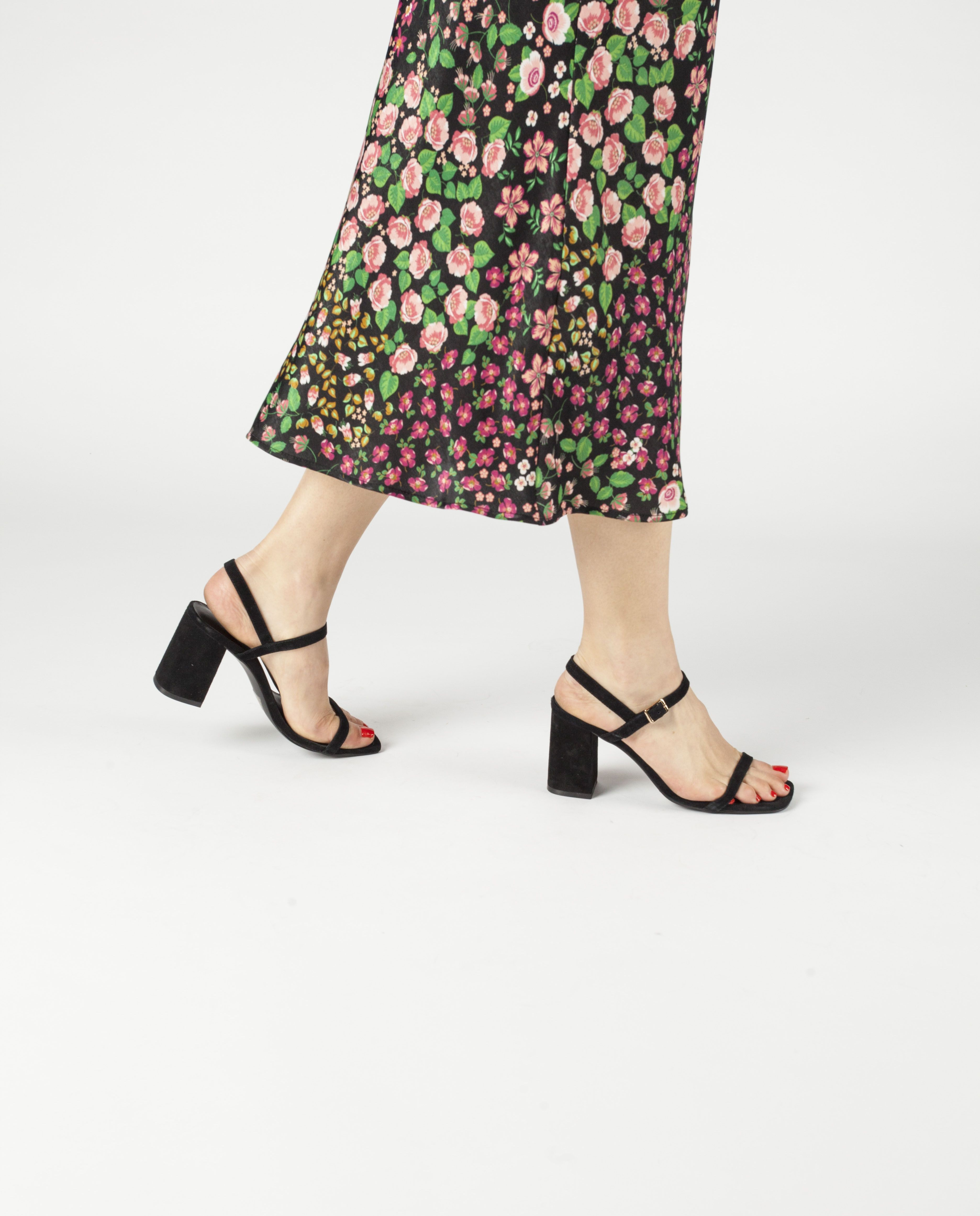 A Chic And Simple Black Suede Strappy Sandal By 2 Baia Vista The Ronnie Has A Gold Buckle Fastening And Fe Strappy Sandals Heels Heels Suede Strappy Sandals