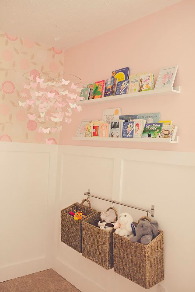 Use metal bar with hanging wooden bins for extra toy storage in the nursery!