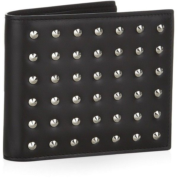 Saint Laurent Studded men's billfold wallet in black smooth leather 260 GBP (at Harrods), sold out. Embossed Saint Laurent logo to back. 8 card slots, 2 note slots, 2 receipt slots. Pure leather. H9.5cm x W11cm x D2cm. Presented with a Saint Laurent dust bag and box. Made in Italy.
