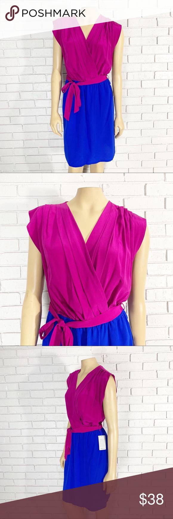 "Presley Skye Women's Silk Colorblock Dress A silk magenta cobalt dress that truly is an attention grabber. Length 34"". Armpit to armpit measurement lying flat 19"". Presley Skye Dresses #cobaltdress"