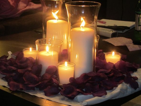 Candle centerpiece pink and purple modern wedding