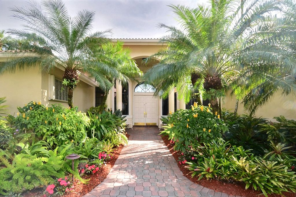 Landscaped Homes tropically landscaped front entrance! home for sale in weston