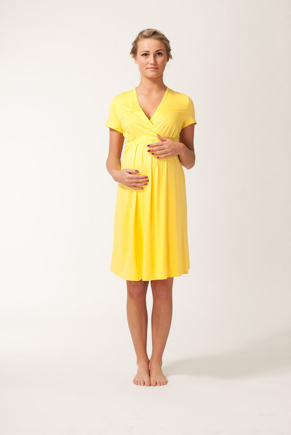 b644763a35cd2 Short sleeve yellow sunflower maternity dress, via Etsy. | Pregnant ...