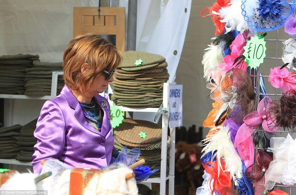 Making an entrance: A lady inspects a stall selling cut-price fascinators as she prepares ...