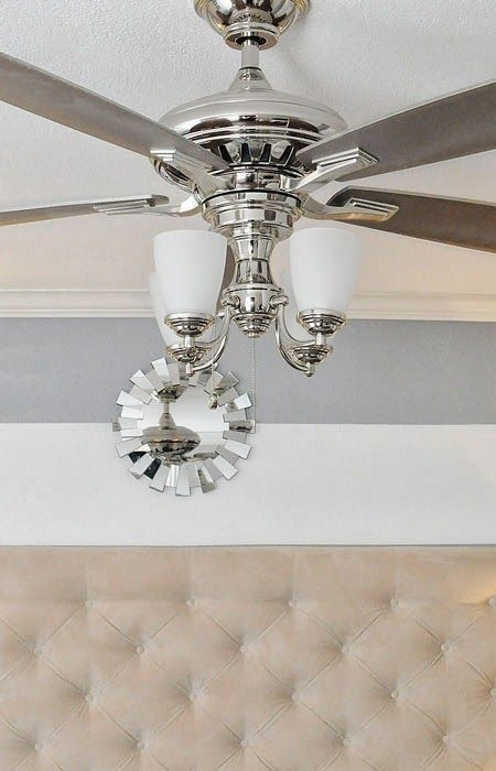 beautiful ceiling fan. chrome finish and gray blades with lights