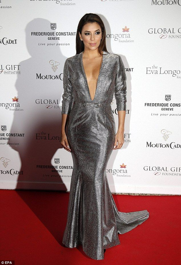 Wow factor: Eva Longoria arrived at the Cannes Film Festival Global Gift Gala in a plunging silver gown