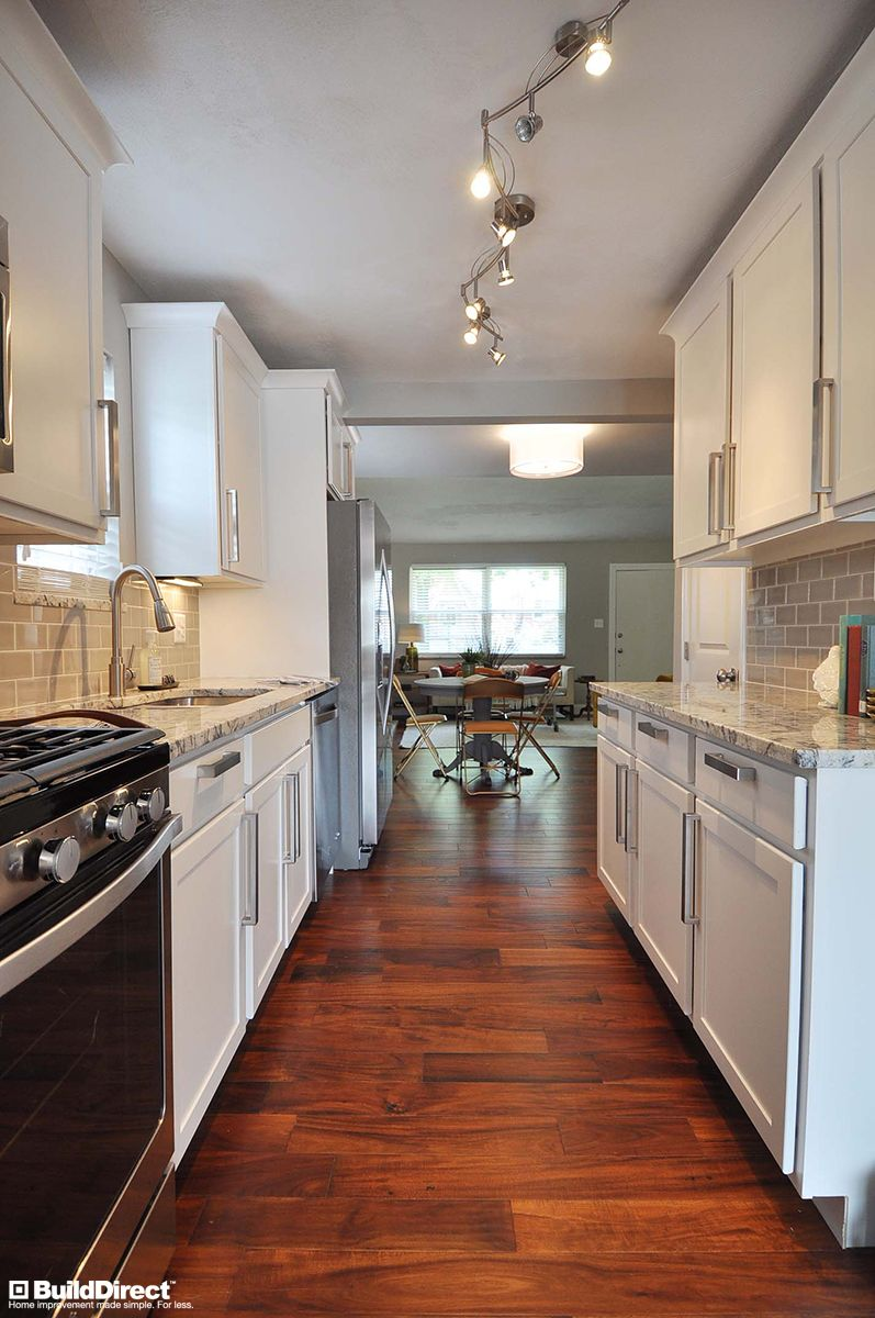 a beautiful galley kitchen featuring acacia engineered