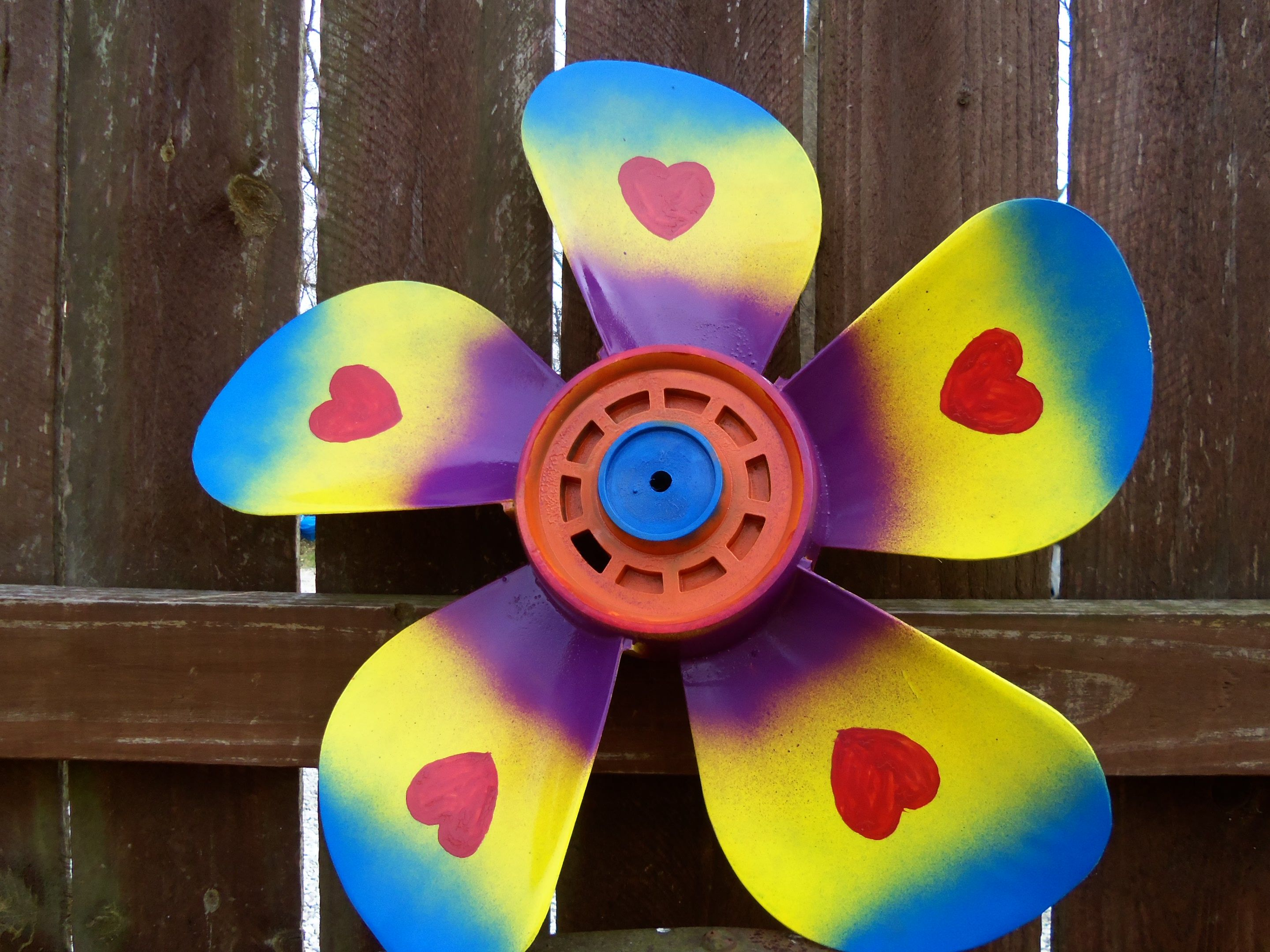 Attractive Painted Box Fan Blade Made Into A Flower Will Put On A Pole With Large Long