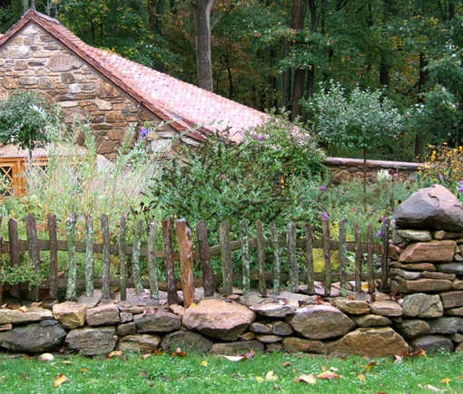 Rustic Fence with Dry Wall - All materials salvaged from forest garden