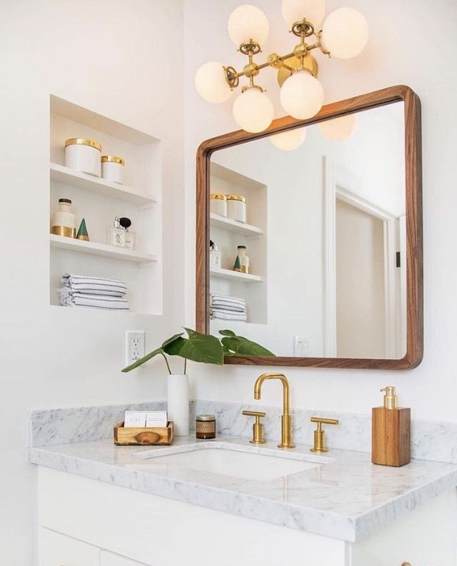 Mid Century Modern Inspired Bathroom With Marble Counter Tops, Gold Faucets, Wood Framed Square
