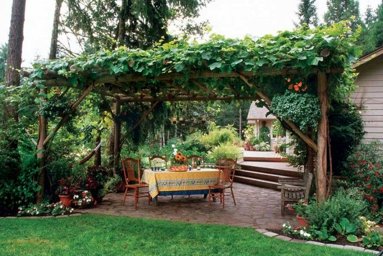pergola built from logs with dining area and patio