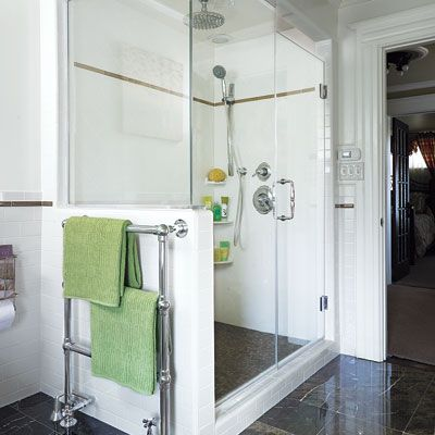 a towel warmer on the outside of this half-walled glass