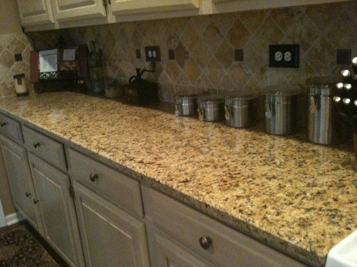 Venetian gold granite countertop with travertine italian Italian marble backsplash