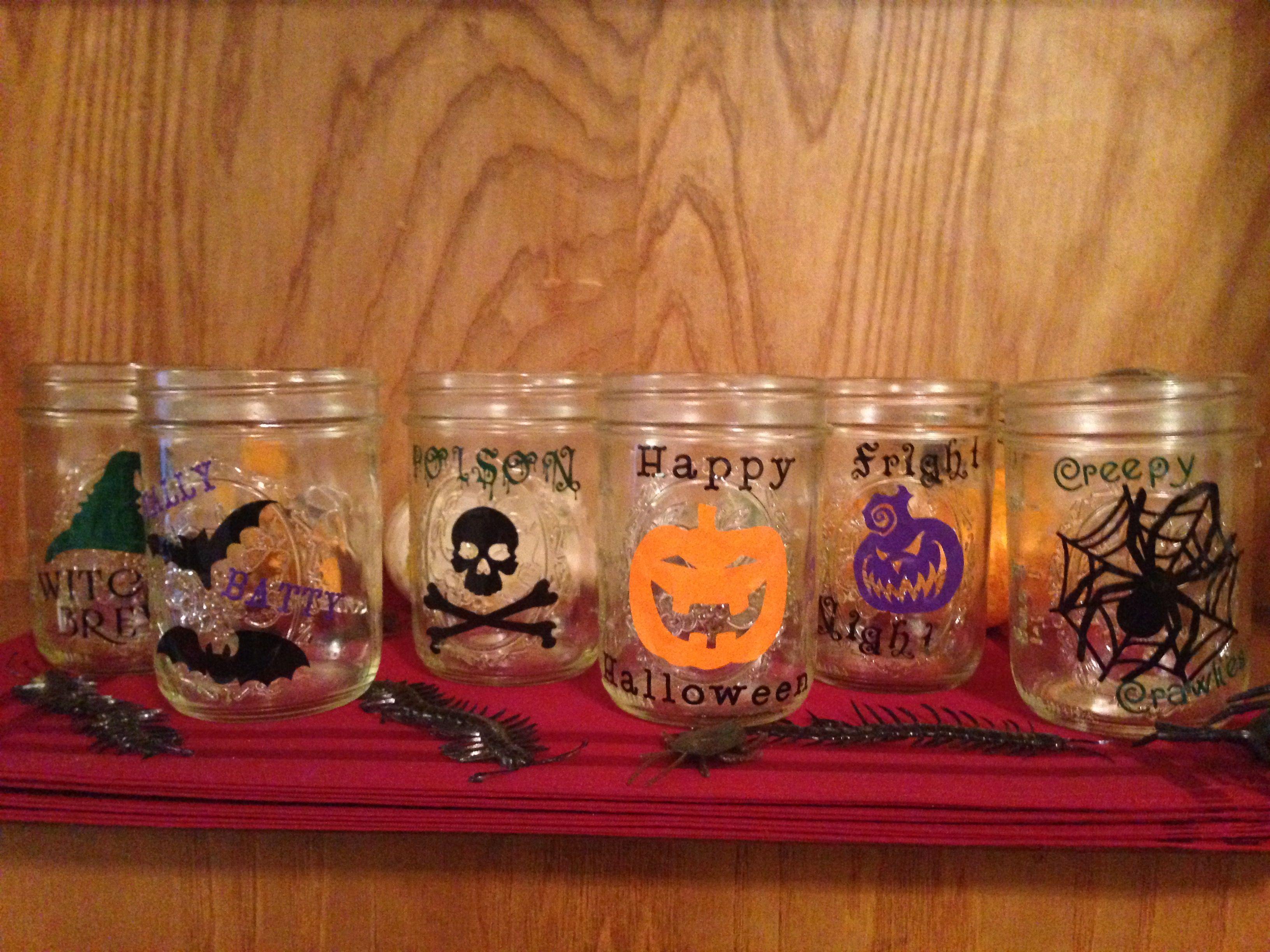 Halloween mason jar drink glasses. Sticky vinyl and Cricut Explore