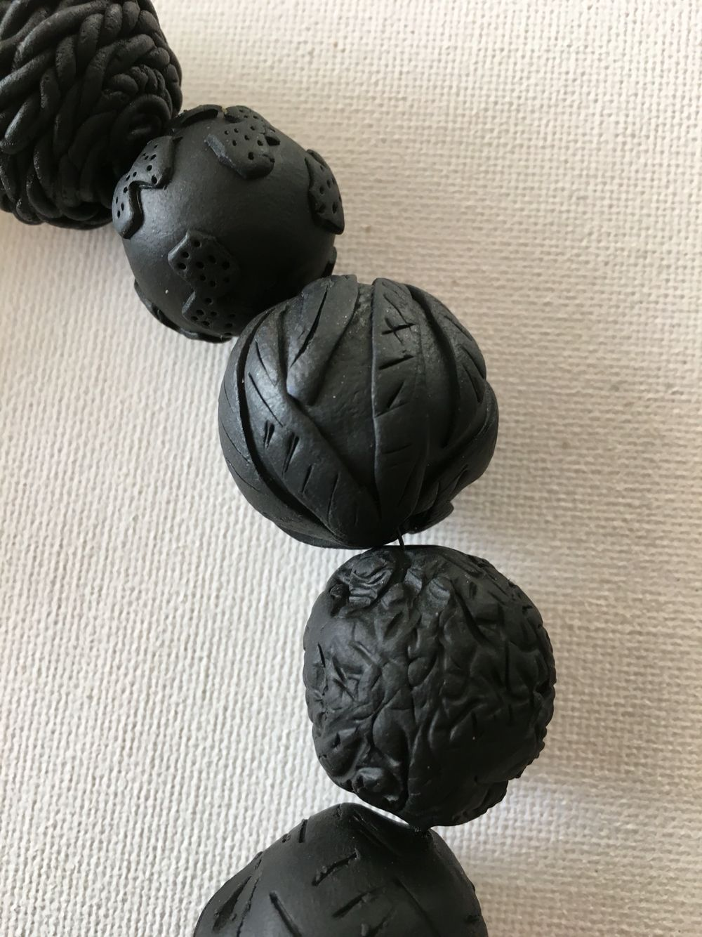 Black structured beads, polymer clay!
