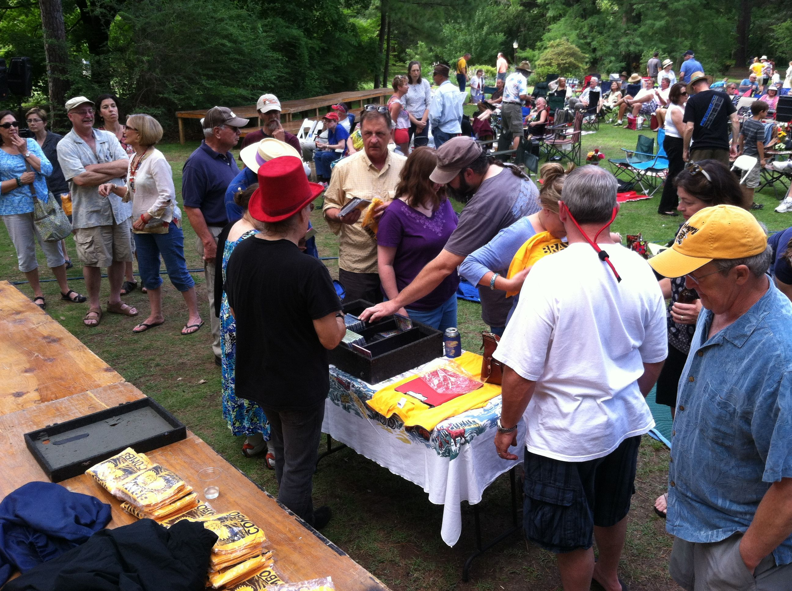 Intermission at the Brave Combo Concert.  Time to sell T-shirts and CD's.     Photo by CS Lent.    June 8, 2014