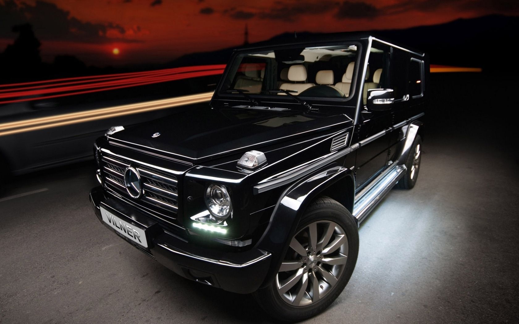 The vilner tuned mercedes g class gets an upgraded interior with high quality beige leather and black alcantara surfaces throughout the car