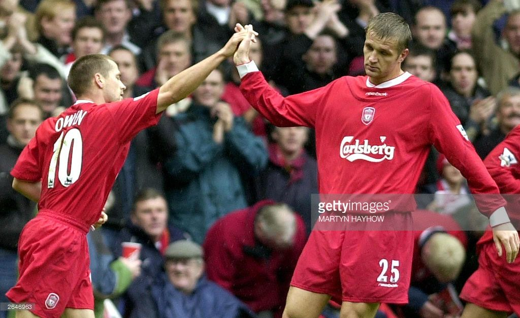 Liverpool's Michael Owen (L) is congratulated by teammate Igor Biscan after scoring his team's first goal against Leeds at Anfield 25 October 2003. Liverpool won the game 3-1. AFP PHOTO/ Martyn HAYHOW