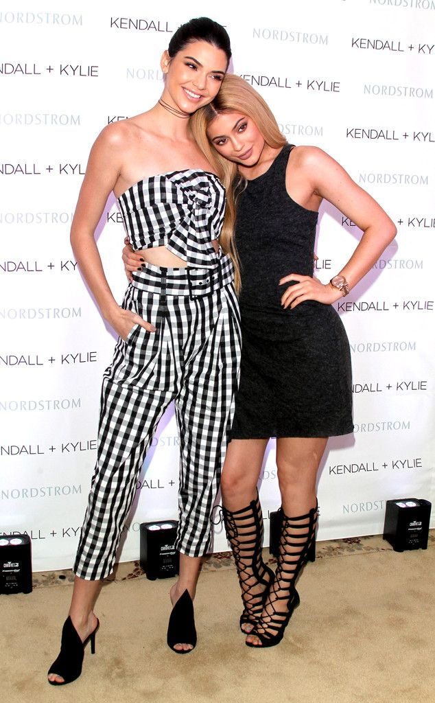 The Jenner girls hug it out during their Kendall + Kylie Spring collection  debut for Nordstrom.