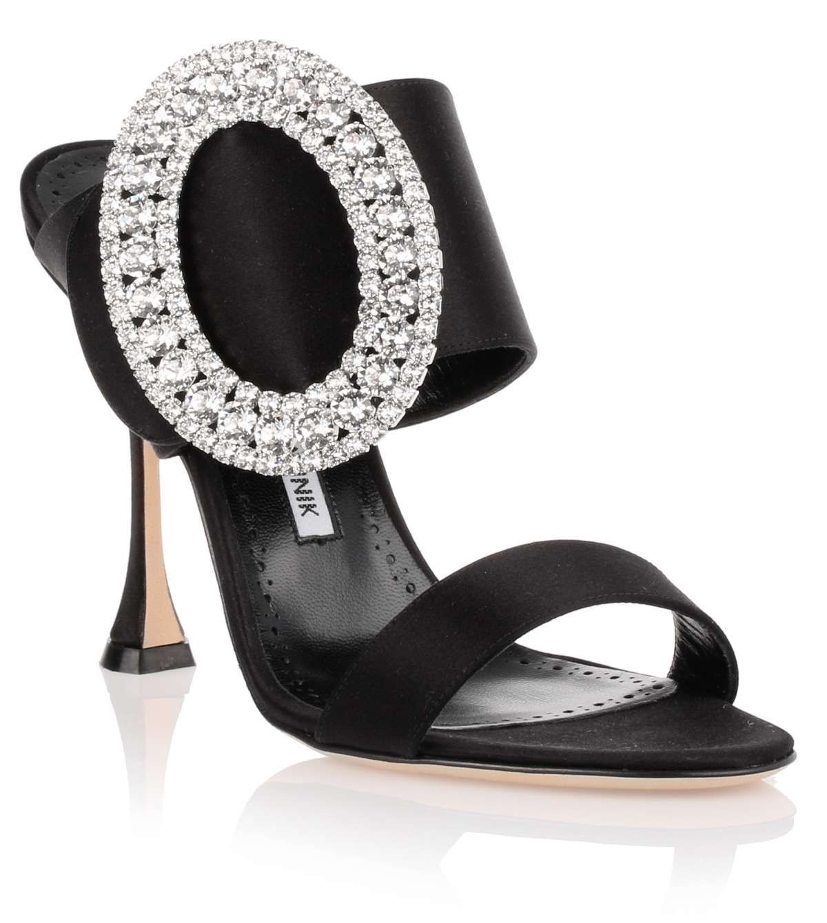 Black satin sandal from Manolo Blahnik. The Fibiona has a 105mm signature heel, a mule design, an a large oval crystal embellishment at the side.True to sizeLeather soleMade in Italy