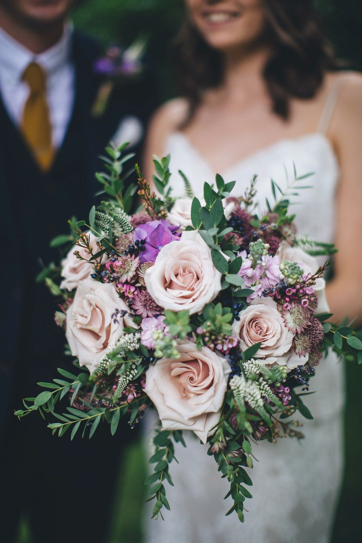 A Justin Alexander Gown and Maids in Navy for a Laidback Restaurant Wedding Wedding flowers
